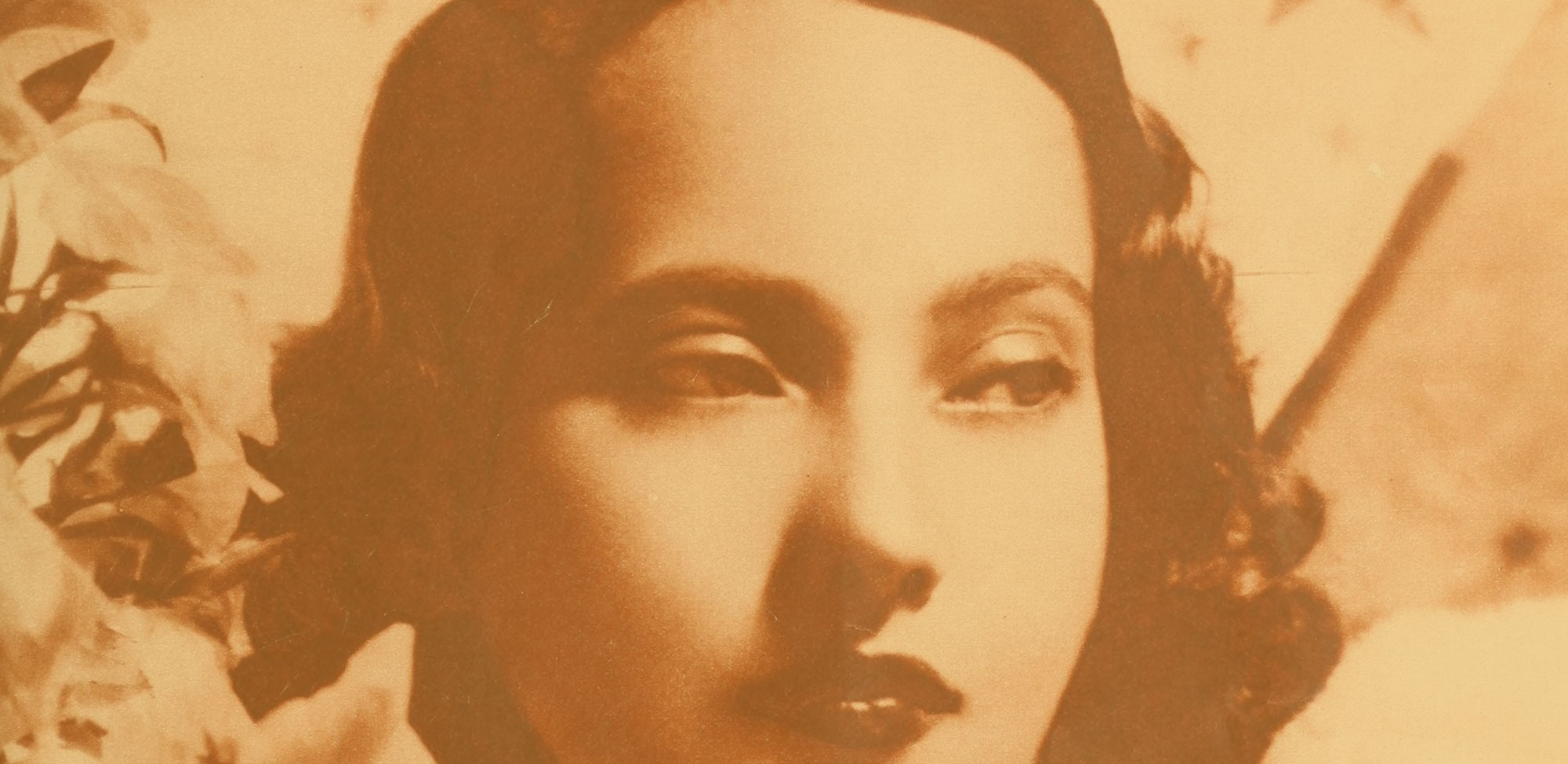 Close up of Merle Oberon's face