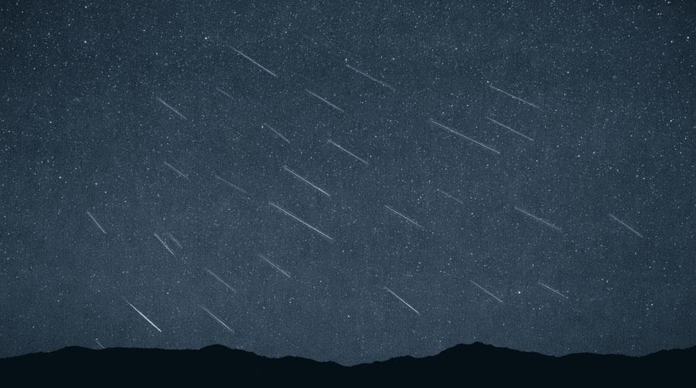 Perseid Shower, blue overlay, night sky.