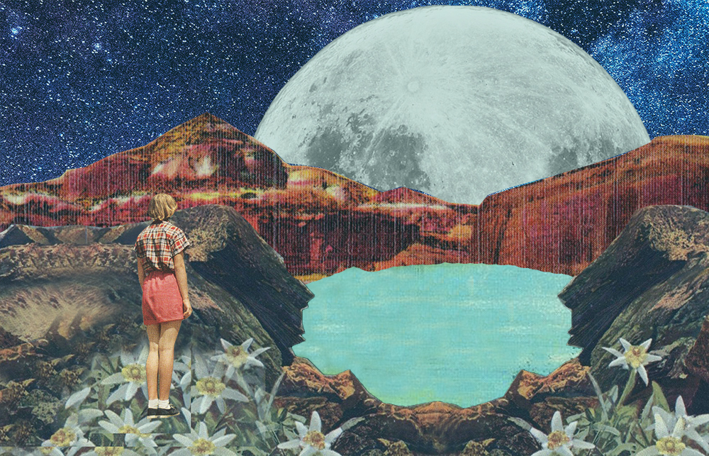 Woman standing on mountain looking a the moon