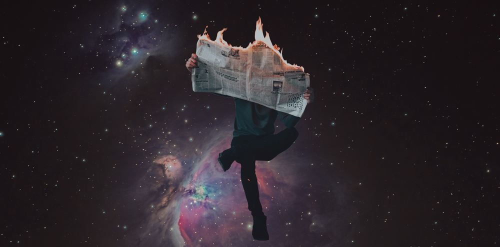 MAN READING BURNING NEWSPAPER IN SPACE